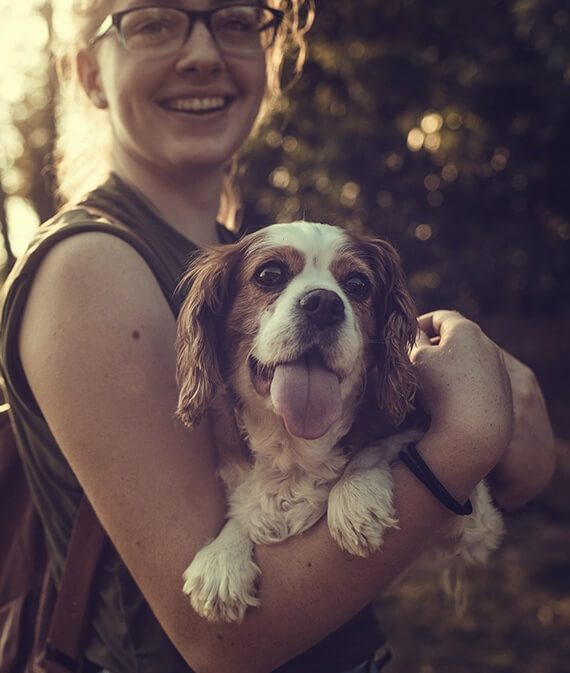 Dog with smiling girl