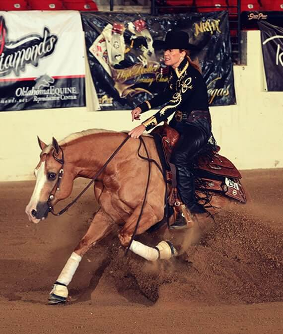 girl riding horse in rodeo