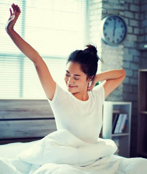 Woman waking up relaxed