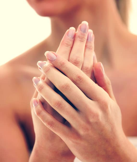 woman applying cleansing hand creme