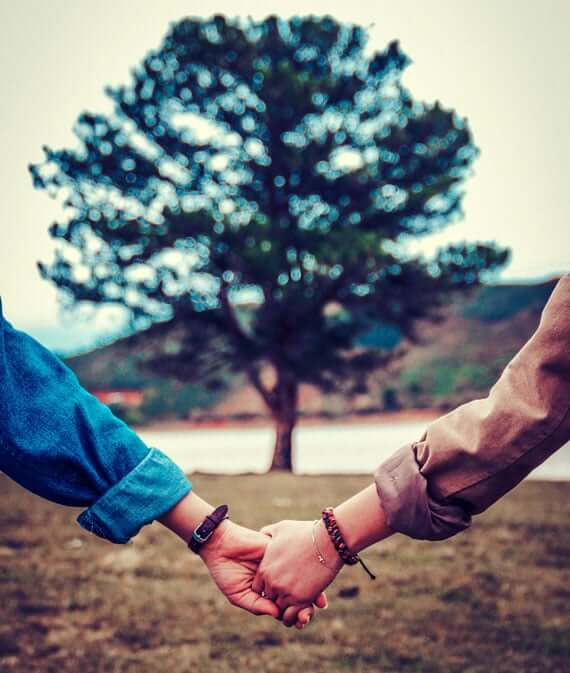 holding hands in nature